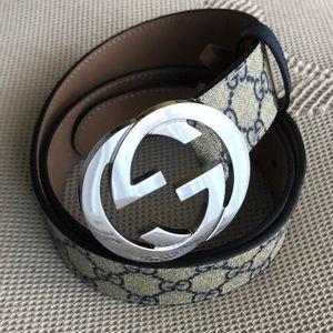 Gucci belt   Blue/beige, silver buckle.